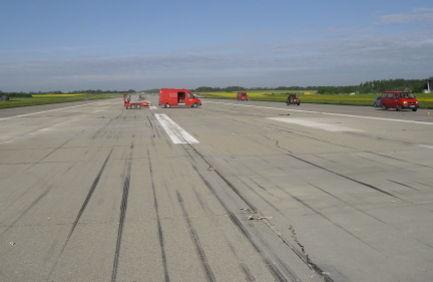 Beschädigte Landebahn
